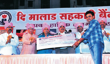 Bank's shareholder Shr. Sandip Upadhyay being presented 'Balika Kalyan Yojana' certificate