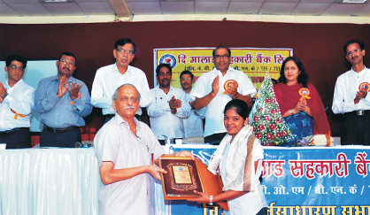 CA exam topper Miss. Prema Jaykumar being awarded by Chairman Shri. Sharad Sathe at AGM on 7-April-2013.